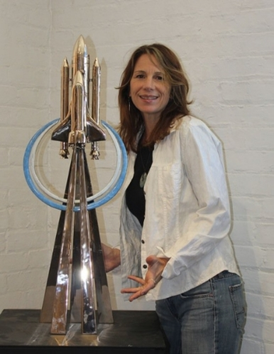Terrie Bennett with the piece she designed for NASA