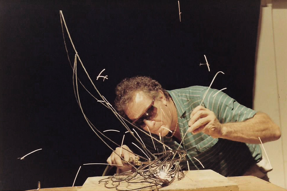 "BOB BENNETT WELDING THE ARMATURE FOR ""AMERICA'S CUP"""