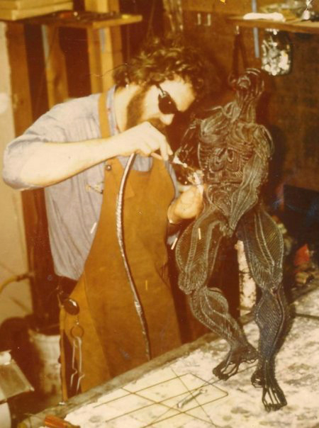 """Tom Bennett in the 1970's working on a wire sculpture, """"Struggle"""""""