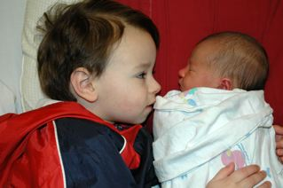 My son and daughter meeting for the first time, 2006