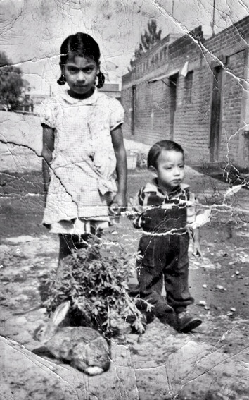 My father age 2 at the slums of Mexico City with his aunt and pet rabbit.