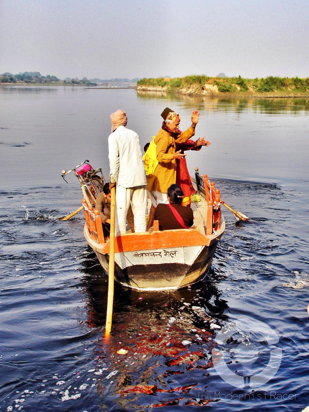 Men dancing at the Ganges river
