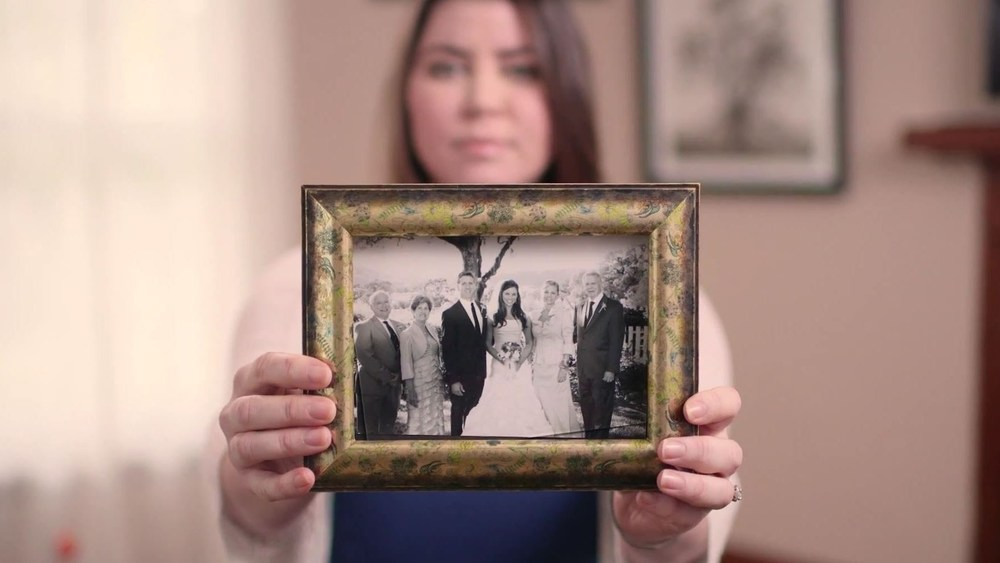 Brittany Maynard holds a wedding picture for a photoshoot prior to her assisted suicide.