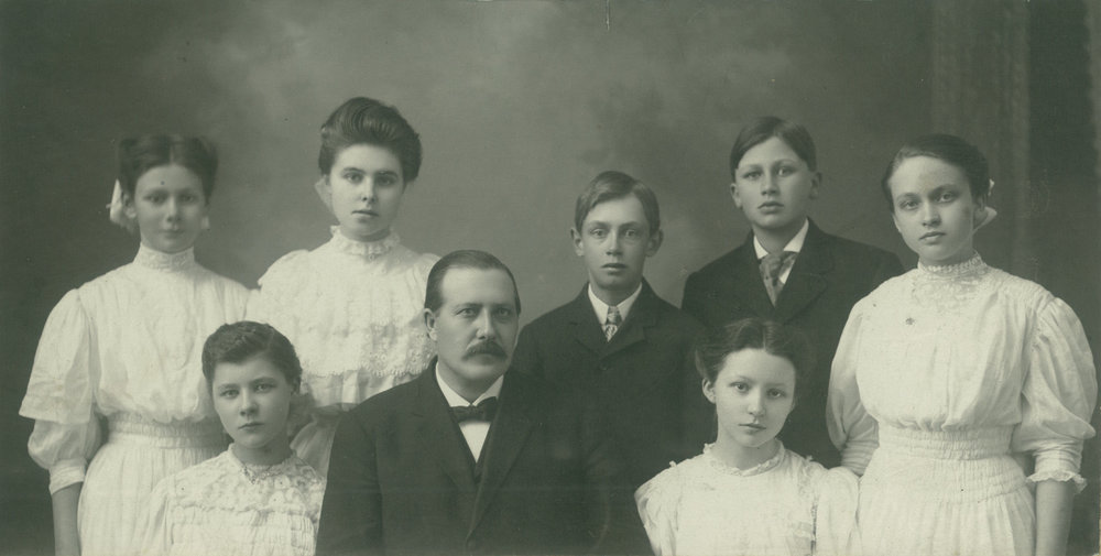 E.M. Broen is surrounded by his children in this 1911 picture. His love and care for his children spilled over into his care for the students at Hillcrest, recognized by Minnie and all who attended the Lutheran Brethren Bible School.
