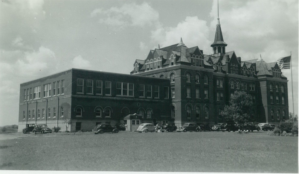 The historic Hillcrest campus pictured likely around the time the school moved in to the dilapitated building after renovating classrooms and dormitories for the delayed school start.