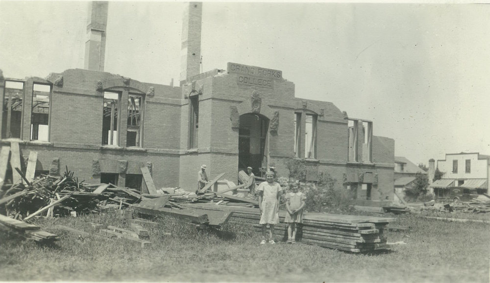 Children gathered to watch the historic Hillcrest building demolition after the Board of Trustees moved to tear the building down and sell the lumber and materials in an effort to raise money during the depression.