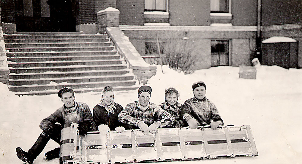 Tobogganing in front of Hillcrest, 1941