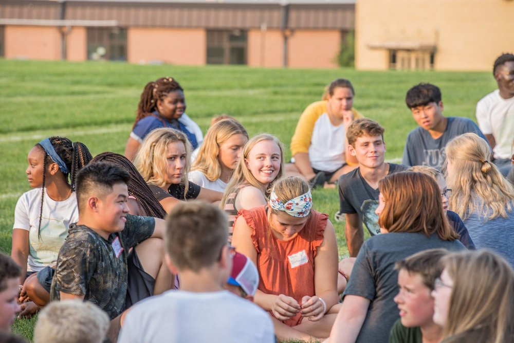 Students gather in small groups during the Welcome Week