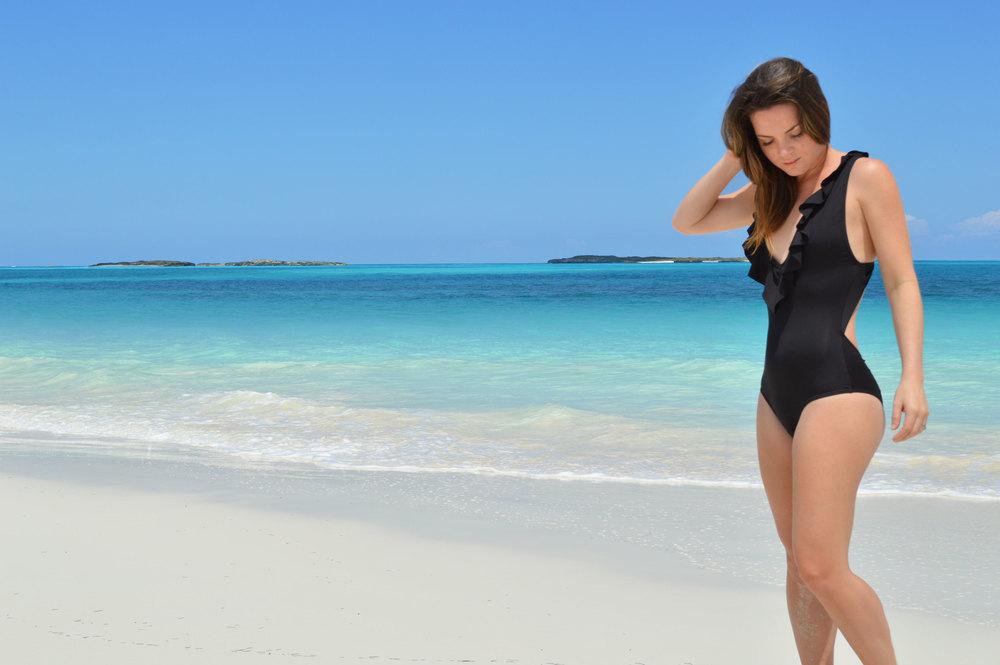 zinke- low-cut-one-piece-black-ruffled-bathing-suit-exumas-bahamas-tropic-of-cancer-beach-nassau-bahamas-top-lifestyle-style-blogger.jpeg