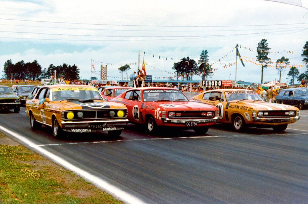 Production racing muscle cars. Patrick Smith in the Falcon GT-HO Phase III lines up next to the E49 Chargers of Rodger Anderson and Leo Leonard