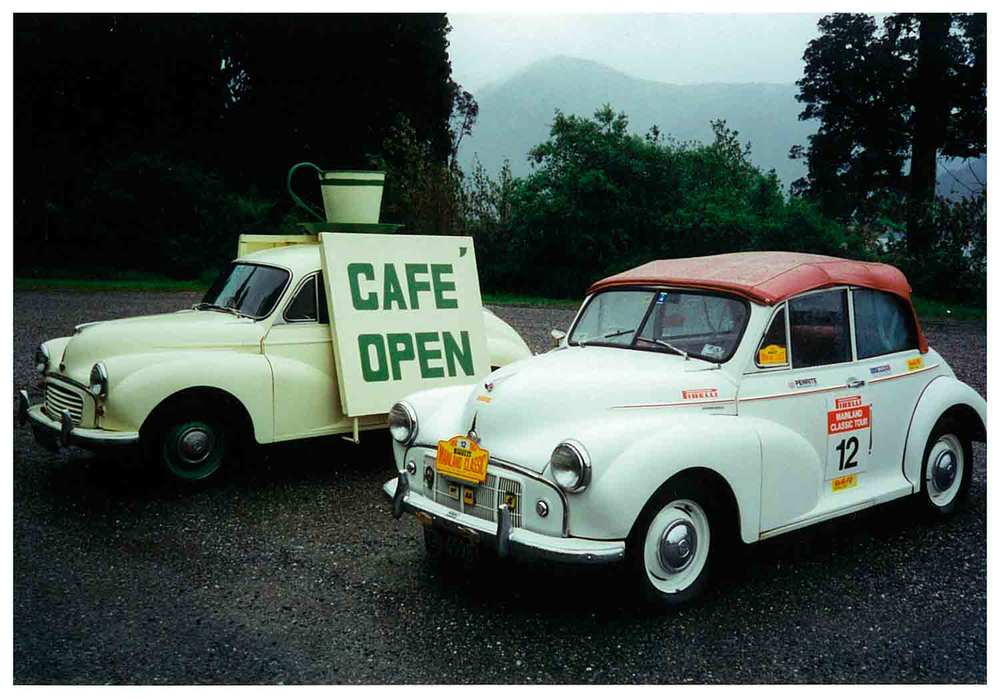 Morris Minor attracting attention to the Open Café — photographed during the running of the Pirelli Mainland Classic Tour, with a tour entrant's Minor convertible parked alongside