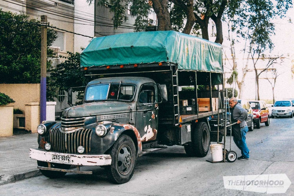 Oldest original vehicle seen that was still in daily use — 19 46 Chev truck, with its long-time owner, that delivers fruit to shops around Montevideo every day