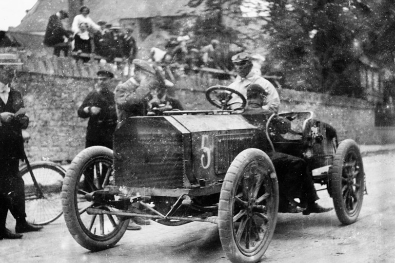 Motor racing pioneer S F Edge at the wheel of a Napier