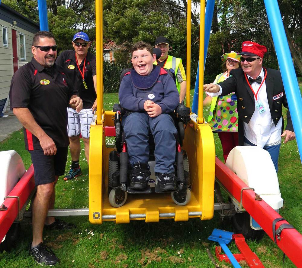 Silverdale's Kaeleb Dovey tries out the Liberty Swing which Bashers donated to his Silverdale School