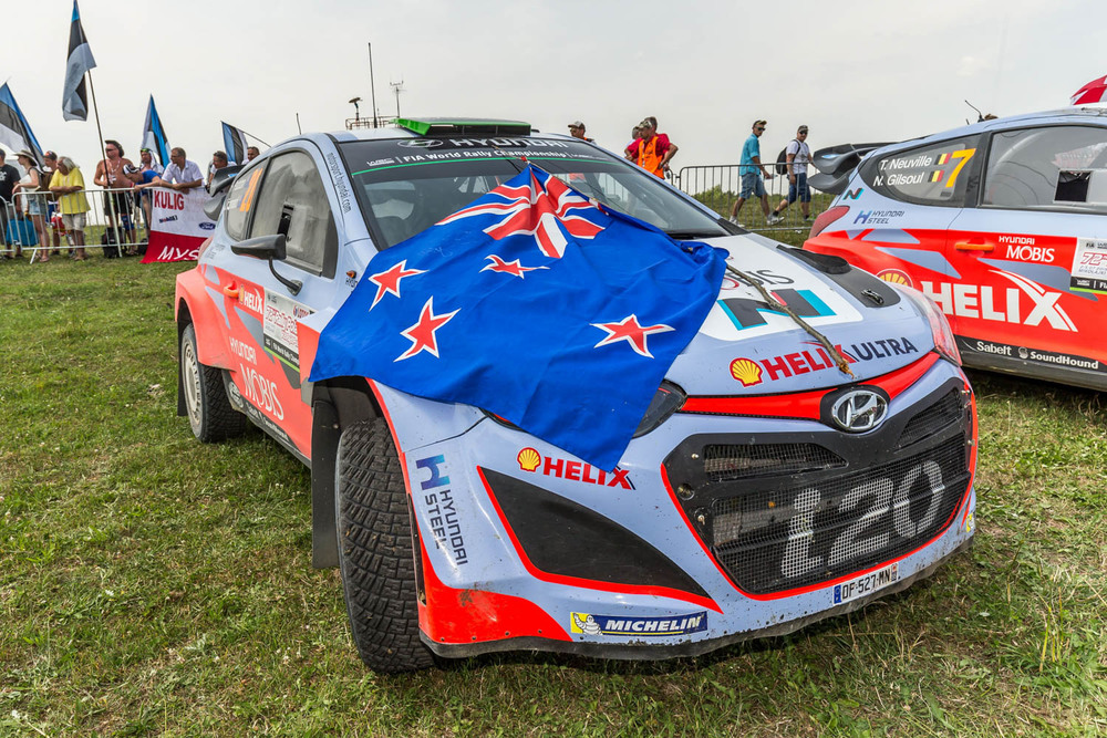 Hayden Paddon and John Kennard WRC Rally Poland Hyundai i20 WRC car with NZ flag Sunday_2 Vettas Media.jpg