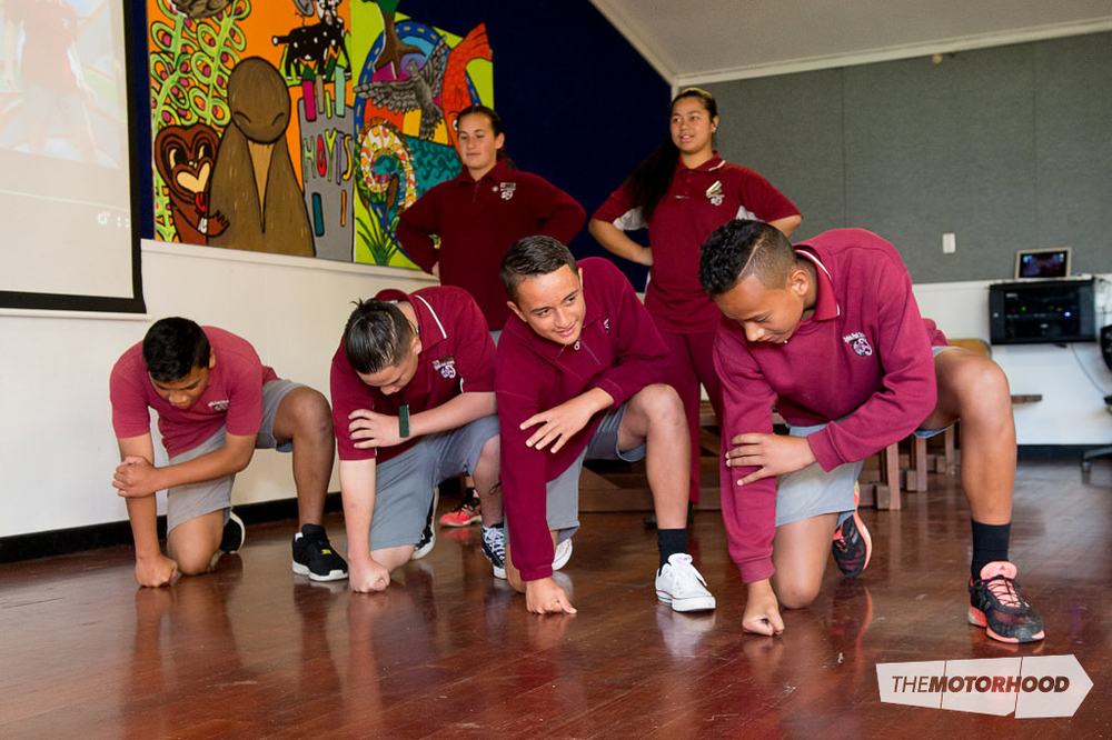 Students Milania Cairns, Annaleigh Taufa (back), Ofa Tonga, Isaiah Smith, Elijah Maruariki-Wiki, and Sam Fanguna (front) performed a haka to wish the drivers luck for the ITM 500 Auckland