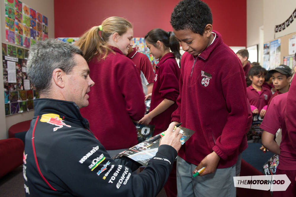 Pulupoi Kaufusi takes the rare opportunity to get Craig Lowndes' autograph