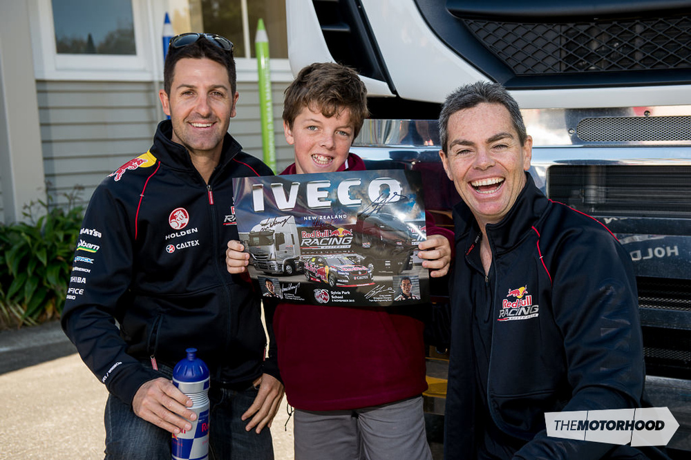 Six-time V8 Supercar winner Jamie Whincup (left) and teammate Craig Lowndes flank Sylvia Park primary student Cole Turner