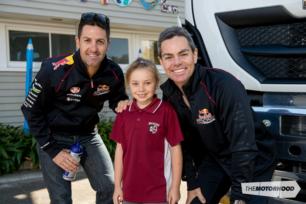 Six-time V8 Supercar winner Jamie Whincup (left) and teammate Craig Lowndes flank Sylvia Park primary student Jadea Ala'alatoa-Dale