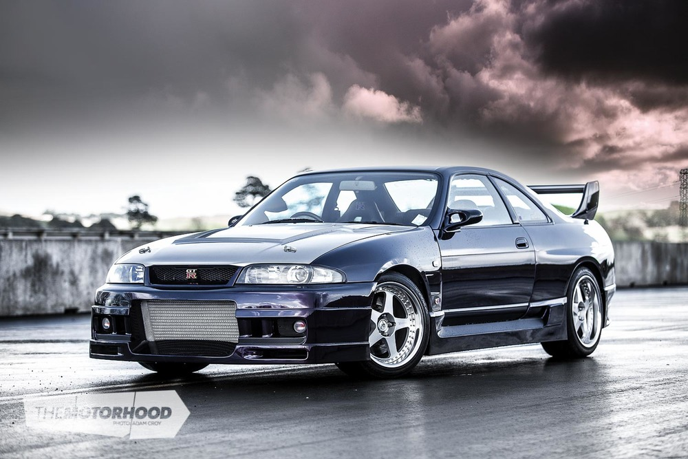 Mark's R33 GT-R body appears factory, but upon further inspection you'll notice everything is much larger and more aggressive. This is thanks to the Trust body kit, GRacer under panel, carbon-fibre rear wing, Top Secret bonnet, and Nismo guards
