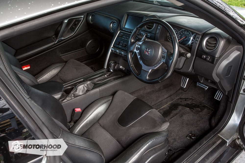 The factory interior in the R35 GT-R has everything you need from an everyday supercar. Air conditioning with climate control, a paddle shift–equipped steering wheel, and a decent factory sound system