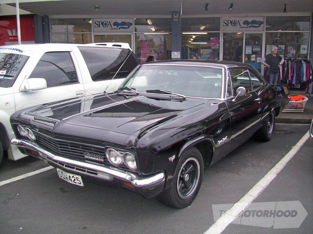 Black is beautiful and so was this black Chevy 2 door. Once again no particulars known about this car or.jpg