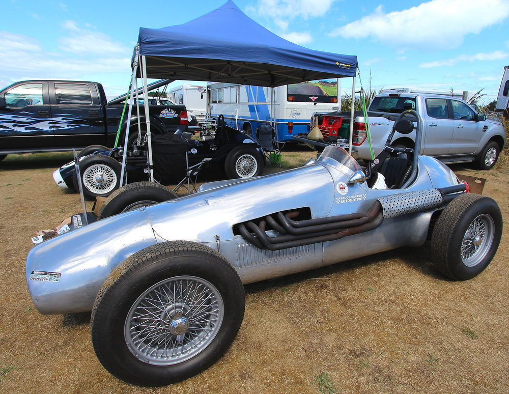 Cooling off: Paul Coghill's (Dunedin) lovely Jaguar Special with Graeme Hamilton's (Lyttelton) ACEIII in the background