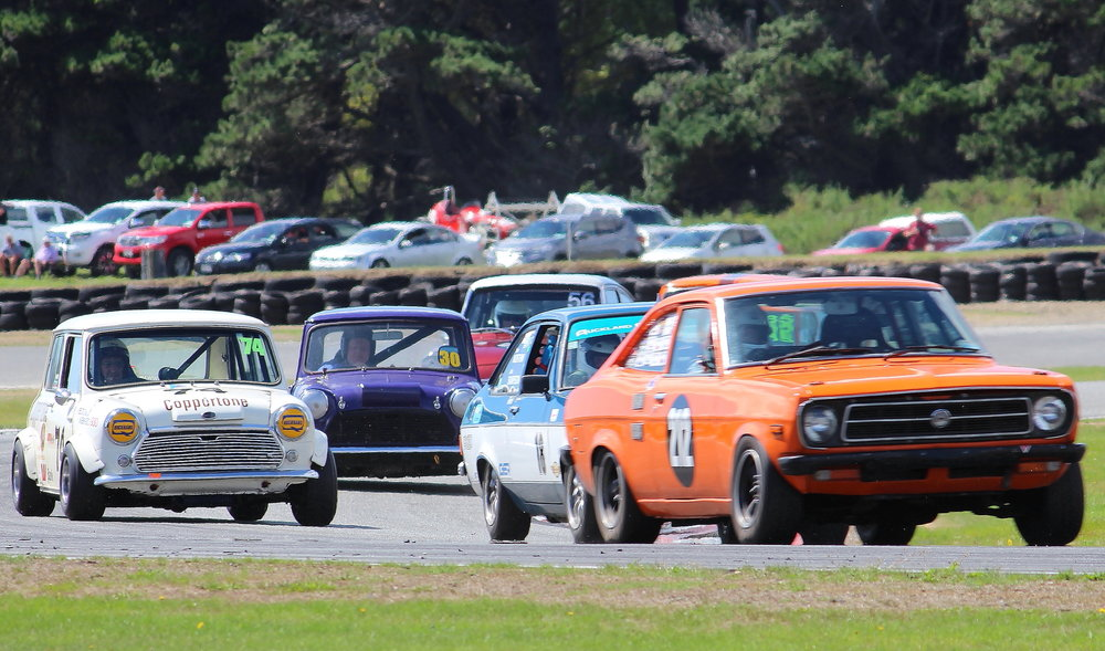 The bunch led by Brent Findlay's (Timaru) little Datsun files through Castrol corner