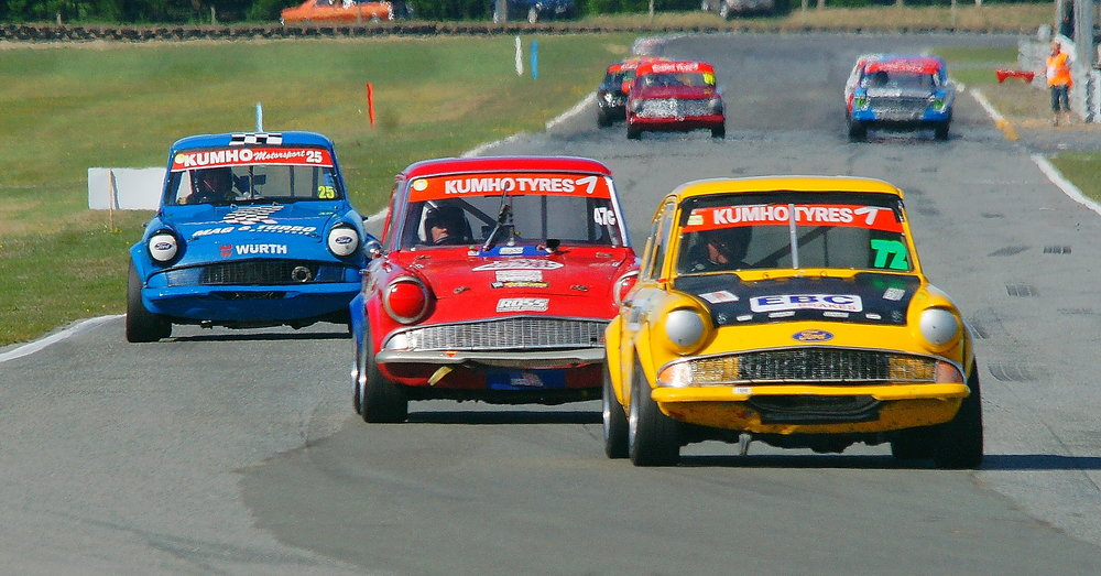 Russell Byfield (Christchurch) leads the Ford Anglias through the loop in the Pre-65 race