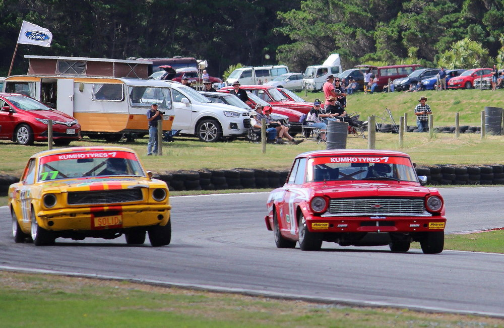 Wayne Tuffley (Invercargill) in his Ford Mustang charges hard to pull alongside Keith McDonald (Dunedin) in his Chevrolet Nova