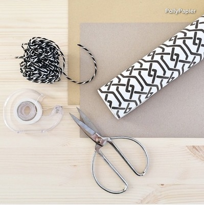 Materials and tools: A4 kraft paper sheets or scrap wallpaper Scissors Tape Decorative string