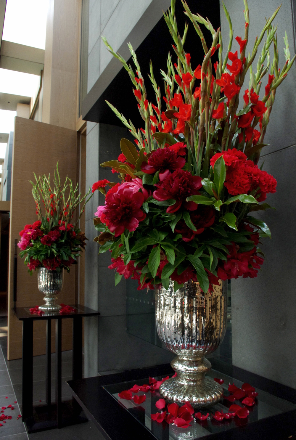 Red urn arrangements courtyard.jpg
