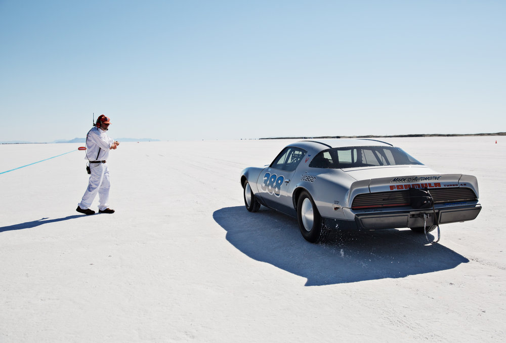"""   Driving Faster Than God on Utah's Disappearing Salt Flats   .""    Photos:   Kim Raff   Role:  Final select and sequence, text edit."