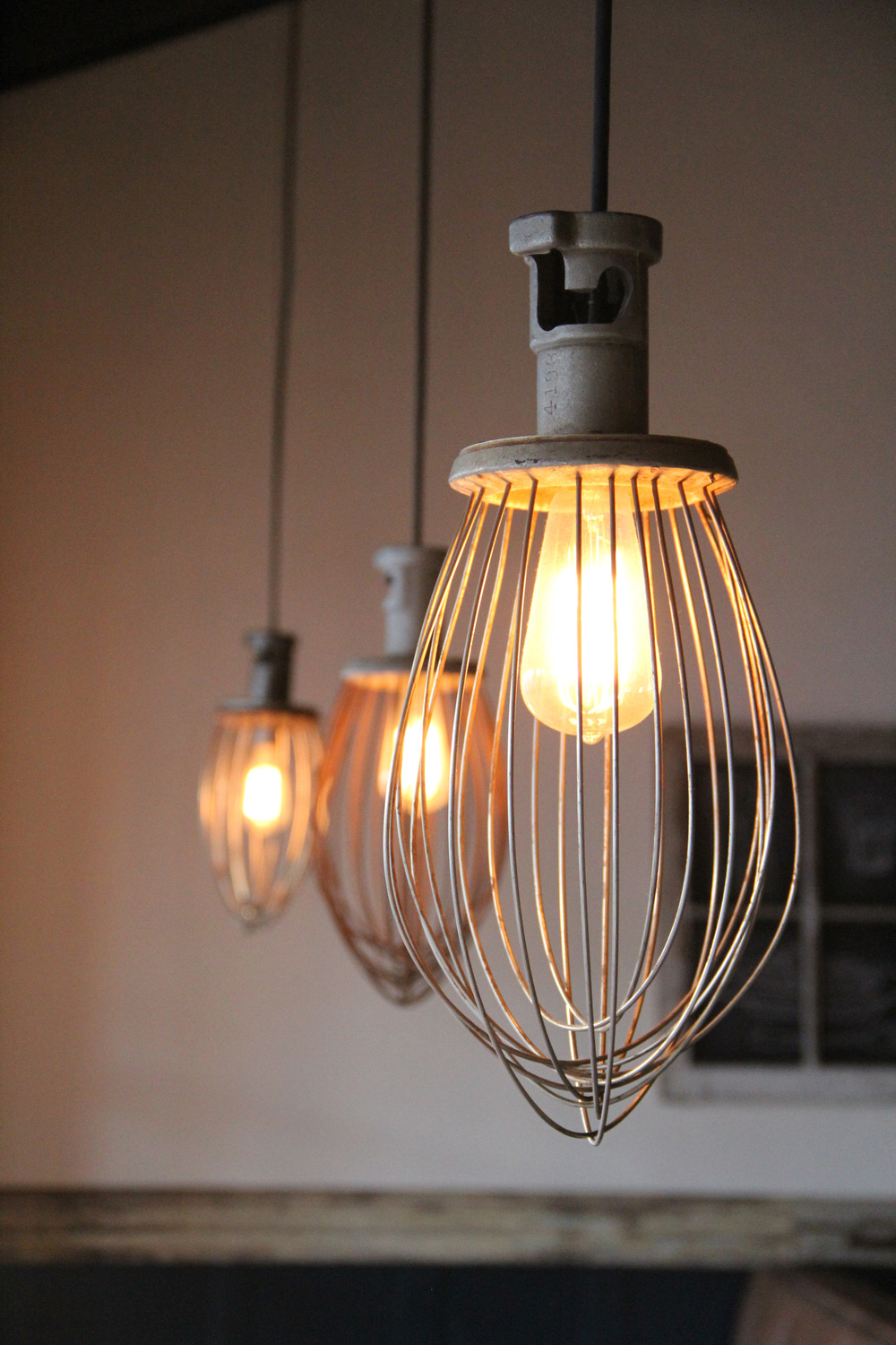 These lights were once industrial whisks, simply wired to hold a light socket.