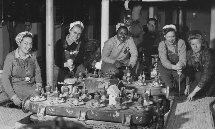 Women shipfitters worked on board the USS Nereus shown as they neared completion of the floor in a part of the engine room at the US Navy Yard, Mare Island, California
