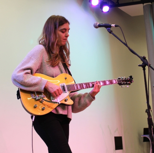 Ali McGuirk performs at the Allston-Brighton Winter Market 2017. Credit: Kristina Latino