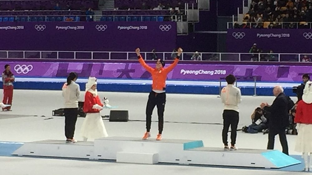 The Speed Skating - Women's 1500m flower ceremony at the PyeongChang 2018 Olympic Winter Games: Jorien ter Mors of the Netherlands (gold), Nao Kodaira of Japan (silver), Miho Takagi of Japan (bronze). Photo credit: J. Gewald [ CC BY-SA 4.0 ],  via Wikimedia Commons