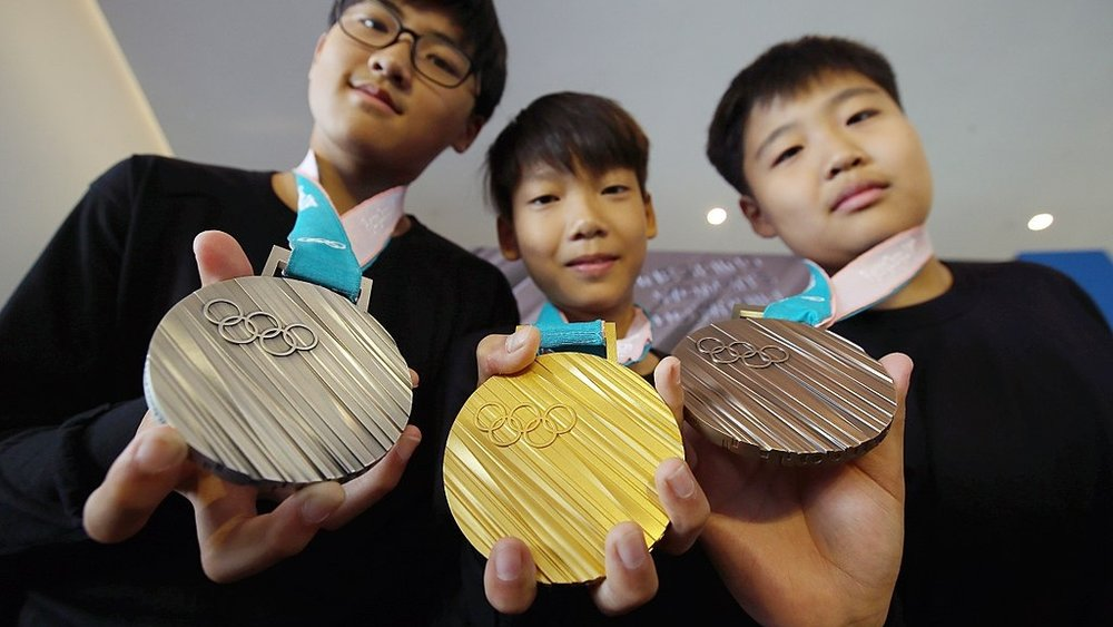 Samples of the PyeongChang 2018 Olympic Winter Games medals. Photo credit:Korea.net / Korean Culture and Information Service [ CC BY-SA 2.0 ],  via Wikimedia Commons