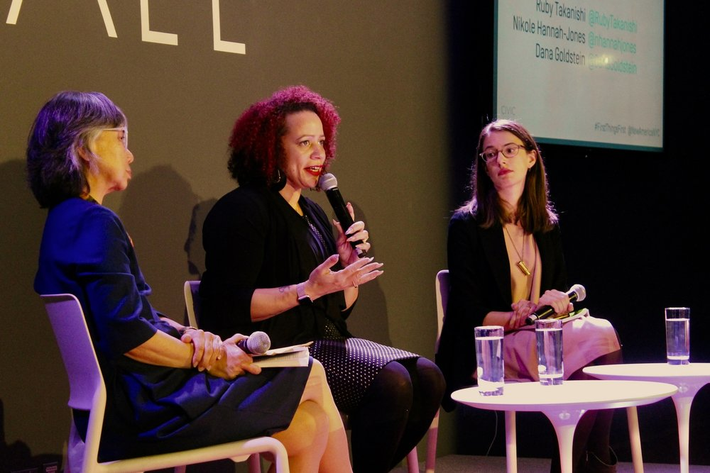 Nikole Hannah-Jones (center) at  Worlds Apart: Redesigning Primary Education in a Divided Society  in 2016. Photo credit: New America [ CC BY 2.0 ],  via Flickr