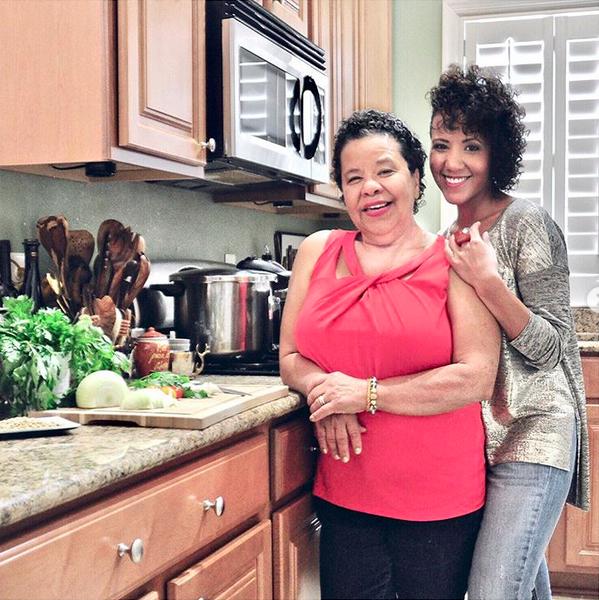 Bren Herrera and her mother in a kitchen