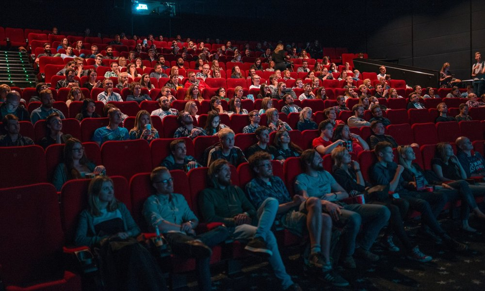 an audience in dark movie theatre