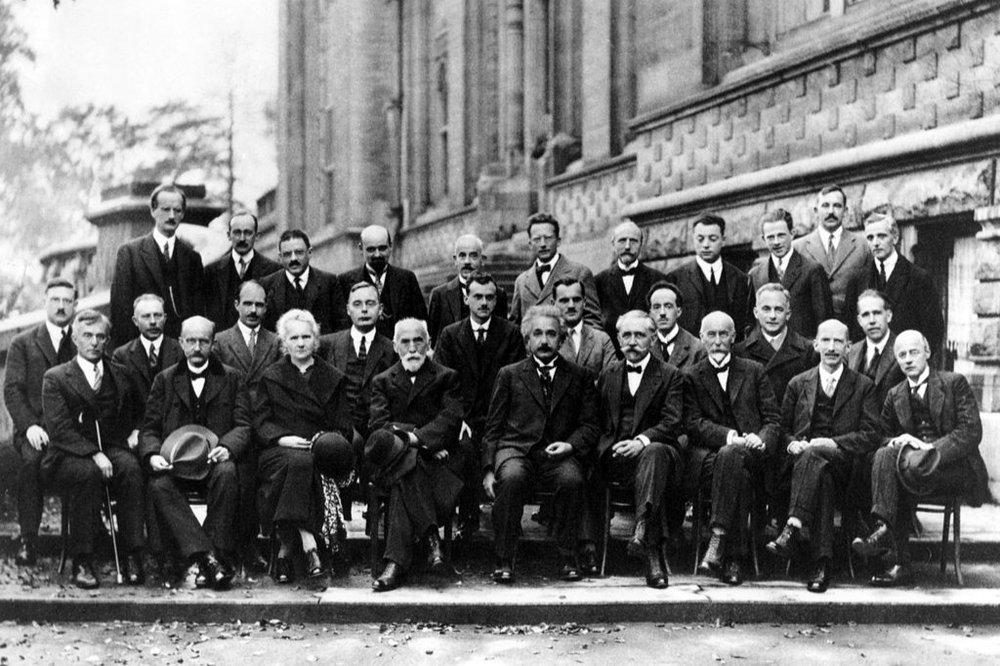 photo credit: Benjamin Couprie [public domain], Institut International de Physique de Solvay,  via Wikimedia Commons
