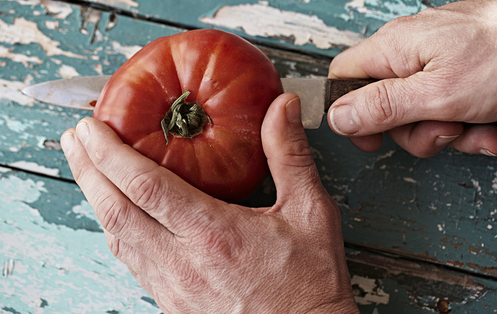 Take one amazing tomato,  (the original brought over from Italy by a great grandfather around 50 years ago). Cut it in half so you can scoop out the middle section including pulp.  Any tomatoe you love the flavour of will do.