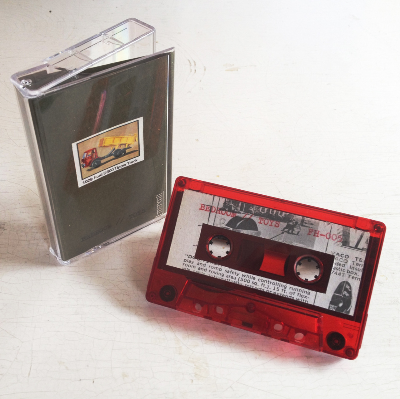 ONE WEEK FROM TODAY / 15 MAY 2012  Furious Hooves  will officially release the extremely limited  Bedroom  EP, Toys, on 24 sexy red cassette tapes, each unique and individually numbered.   As always this release was handmade by the loving hands at furhoof and will include a special surprise with each purchase. And there you have it!