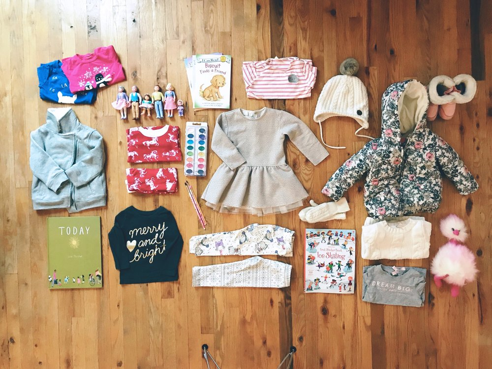 Top Centre Clockwise:  Pink Striped Shirt |  Zara,  Taupe Dress |  Zara,  White winter hat |  H&M,  Winter jacket |  Joe Fresh,  Pink Boots |  Joe Fresh,  Pink Pom Pom |  Bib & Tucker,  White Cable knit sweater |  Carters , Grey Dream Big Shirt |  Carters,  Ice Skating Sticker Book |  Indigo,  White Cable knit Mittens |  H&M,  Winter Girls leggings |  The Gap,  Nordic Leggings |  The Gap,  Merry & Bright Shirt |  Carters,  Today Book |  Indigo,  Grey Zip Sweater |  The Gap,  Winter graphic shirts |  Carters,  Red Horse Pyjamas |  The Bay,  Water colours |  Micheals ,  Paint Brushes | Korea, Fisher Price Dollhouse people |  from my childhood,   Buiscuit Book series |  Gift from Great Aunt Susan and Great Uncle Neil