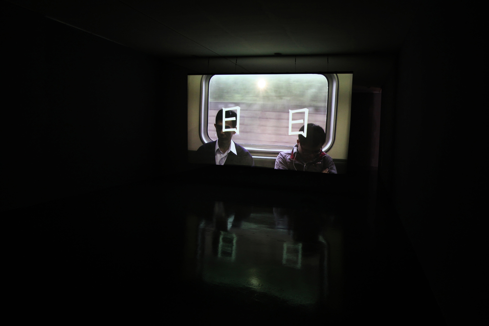 """The exhibition scene in Kuandu meseum of Art, Apr 2011 - to see from the right side  <Daily> is a two-channel video installation through two oncoming projections. Oneprojects the story about Taipei city, the other projects a light (shooting before) in theexhibition space. The two images merge in the screen, and the light shifts to the sun in themiddle of the landscape. Because of the mimic sun, the normal life become more and moreequivocal and fascinating. Also, the films' title """" Daily """" has double-entendre meaning in Chinese - literally """" day by day """" and hieroglyphically compiled by two """" Sun """" characters (日日).Project <Daily> constructs the space emerging the essence of Taipei city throughdocumentary, fiction and real life."""