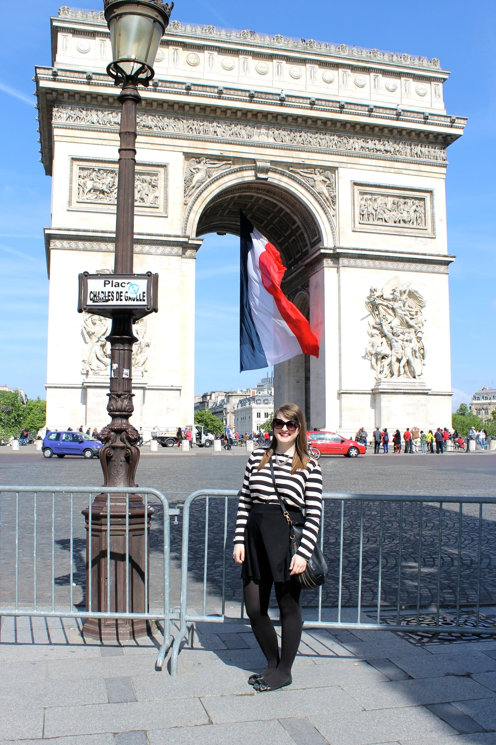 After our half day in Paris on the 16th, we set out the next day to see all of the land marks. We got off the metro at the Champs d'Elysees stop and the Arc de Triomphe was majestically awaiting us. So gorgeous!