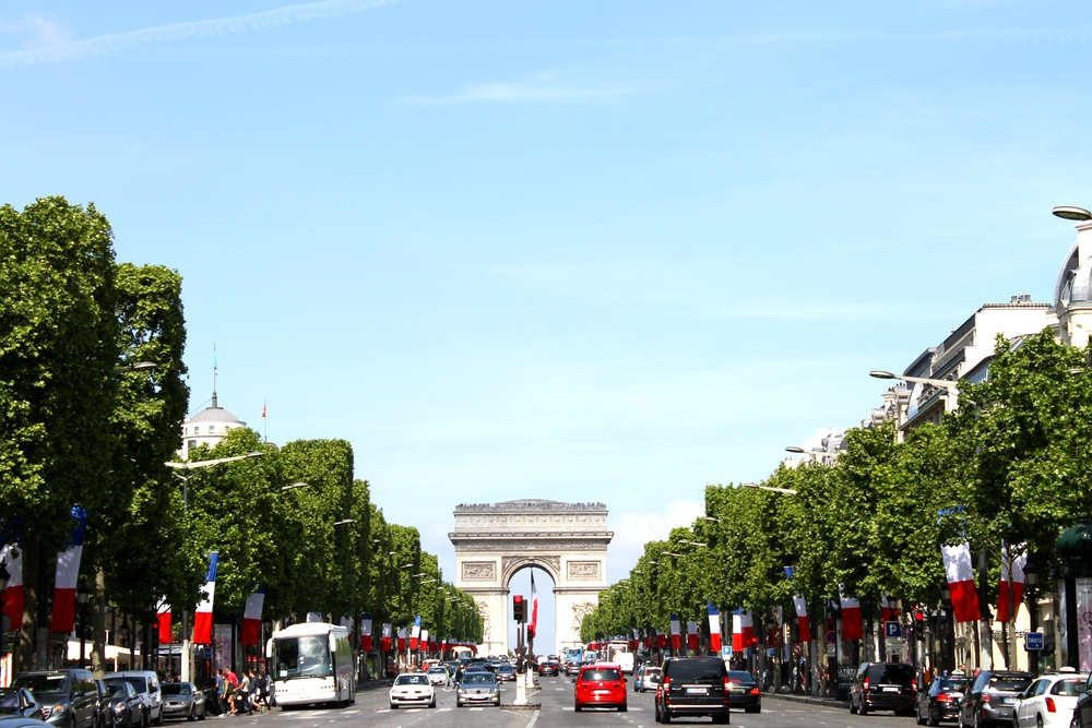 L'Arc de Triomphe as seen from the middle of the street along the Champs d'Elysees.
