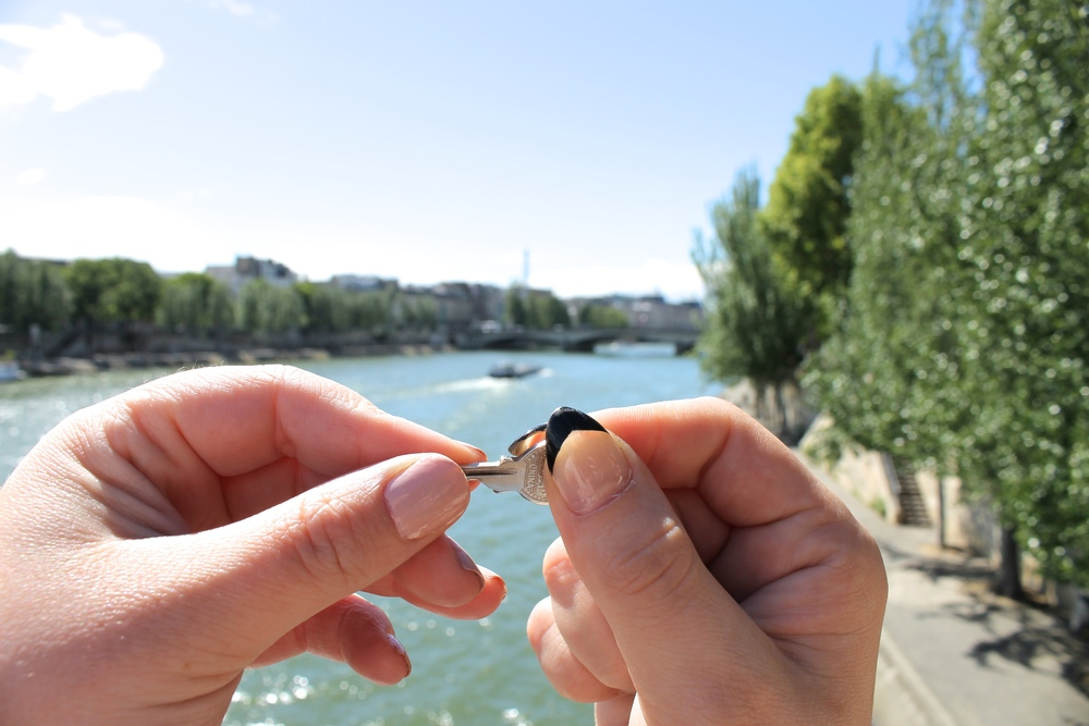 Throwing our key into the Seine river! We will be back someday Pareeeee.