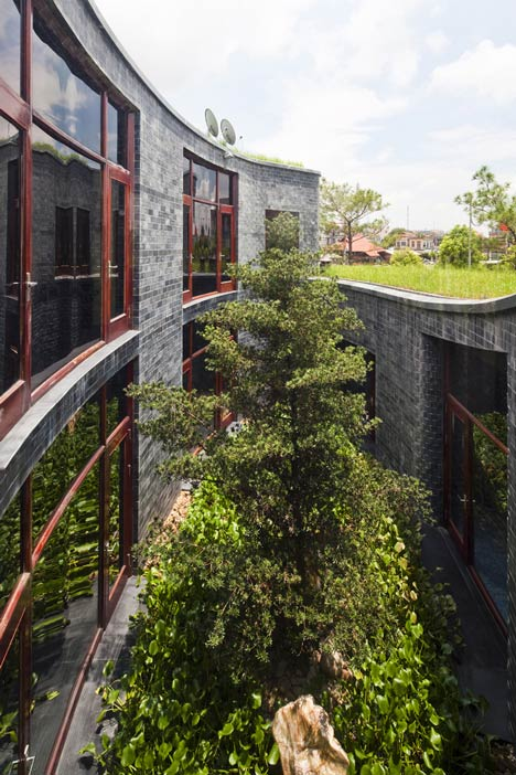 Detail Collective | Outside Spaces | Stone House Vietnam by Vo Trong Nghia | Image:  Dezeen / Hiroyuki Oki